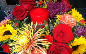 Family Holiday Fall Centerpiece with pillar candle in Bethel, CT   BETHEL FLOWER MARKET OF STONY HILL