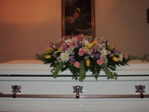 Feminine Tribute Casket Spray in Lincolnton, NC | DRUM'S FLORIST & GIFTS