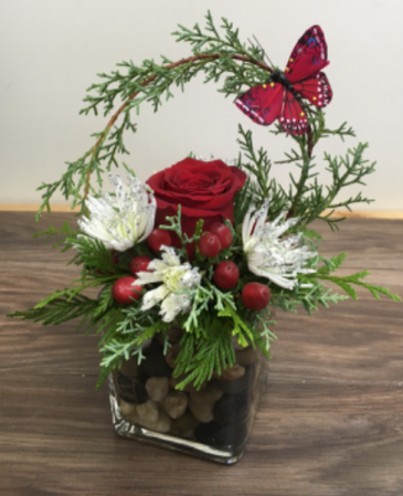 Festive rose on the rocks Christmas arrangement