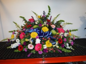 FG colorful remembrance Casket Spray in Barnesville, OH | THE FLOWER GARDENS