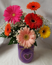 Mixed Gerbera Daisies in a heart mason jar. (mason jar may vary in color)