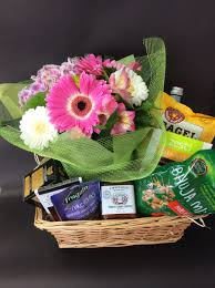 Flowers and Goodies for Mom gift basket with a wrapped bouquet