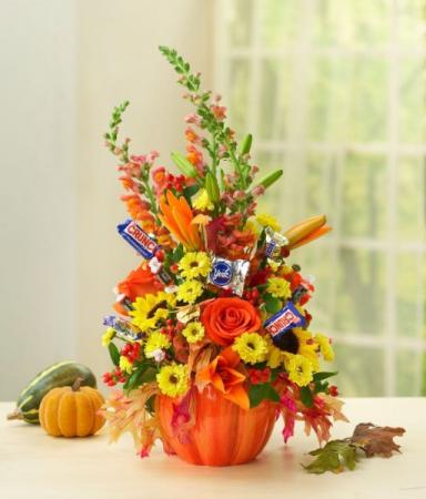 FLOWERS AND TREATS PUMPKIN ARRANGEMENT