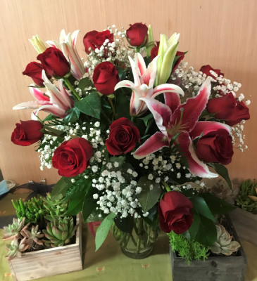 For My Star. vase arrangement of Red Roses and Stargazers