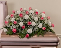 FOREVER IN OUR HEARTS Half Casket Spray of pink Roses and white carnations and baby's breath. ( any color roses and carnations can be substituted if available)