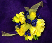 freesia and delphinium wrist corsage