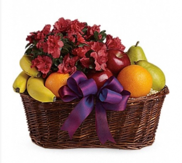 Fruits and blooms Basket with assorted fruit and potted blooming plant