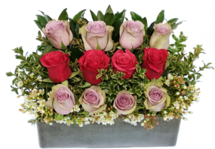 Fuchsia Wall Of Roses Container Arrangement