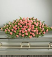 FULL COVER CARNATION CASKET SPRAY 200.Carnations avalilable red,white or yellow