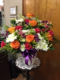 Funeral Arrangement Mache' filled with flowers of choice
