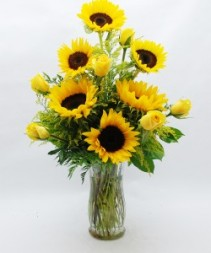 WARM THOUGHTS Sunflowers or yellow gerbera daisies and yellow roses arranged in a vase(nice take home arrangement after services)