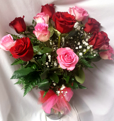 6 Red Roses and 6 Pink Roses arranged in a vase With filler!