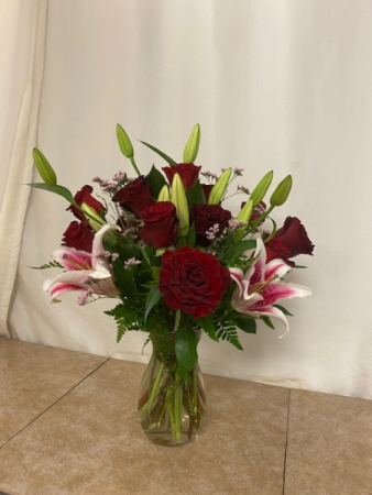 Gazers and Roses Vase of stargazers and red roses
