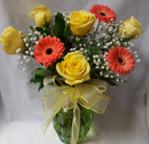 Gerbera Daisies with yellow roses arranged in a  vase with bow!!