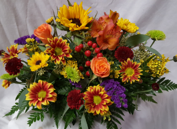 Fall Centerpiece with Seasonal bright flowers.