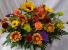 Fall Centerpiece with Seasonal bright flowers.