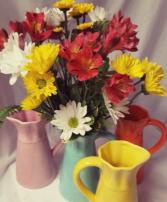 Summer Charm Bouquet...Seasonal flowers...daisies, Alstramaria lilies,arranged in a bright keepsake pitcher.