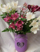 Heart Mason Jar filled with alstramaria lilies And fillers (colors of heart mason jar and Alstramaria Lillies may vary)