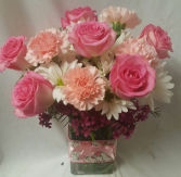 """PINK DELIGHT""...PINK ROSES, PINK CARNATIONS, and white daisies with filler arranged in a cute ribbon detailed rectangular vase!"