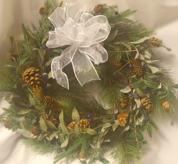 "22"" in diameter Artificial wreath with   different greens, pinecones and blueberries. Looks very real! Can be used on the outside or inside of a door. Also can be used as a centerpiece with a fat candle, lantern or globe in the center. Great gift to be used year after year!"