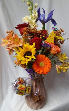 Beautiful Autumn ceramic Vase with dangling  Fall leaves and seasonal  flowers arranged with Birthday Pic and also comes with a small bag of miniature chocolates.