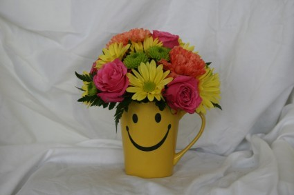 Give Them A Smile Smiley Face Mug Arrangement In Conroe Tx A