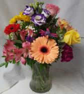 """Hummingbird Arrangement"" Mixed flowers arranged in a vase with a hummingbird!"
