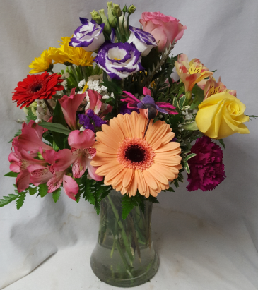 """Hummingbird Arrangement"" Mixed flowers arranged in a vase with a hummingbird!"