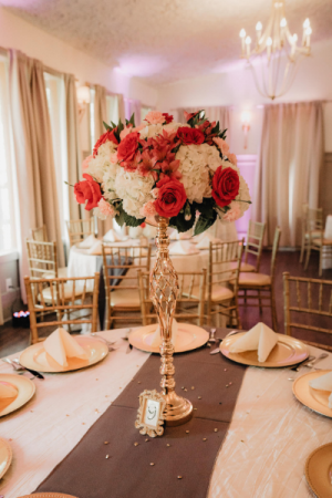 Gold riser bouquet of hydrangea and roses wedding