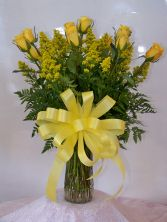 Gold Stripe Roses Classic dozen roses in vase with filler, greens, and a bow.