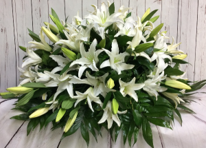 Graceful Lilies  Casket Spray in Culpeper, VA | ENDLESS CREATIONS FLOWERS AND GIFTS