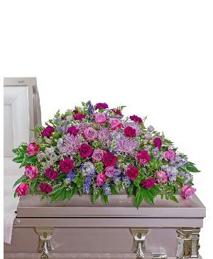 Gracefully Majestic Casket Spray Sympathy in Nevada, IA | Flower Bed