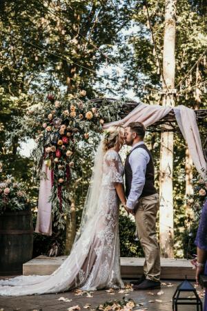 Grand Barn arch with Corner spray and blush curtai wedding
