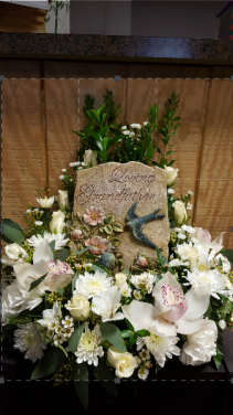 Grandfather Tribute Statue with floral wreath surround