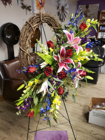Grapevine wreath with fresh flowers  Standing spray