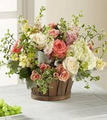 Green and Peach Basket Flower Basket Arrangement