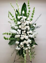 """GREEN AND WHITE STANDING SPRAY"""" WITHOUT """" ANGEL """" WAS 255.00. NOW $185.00"""