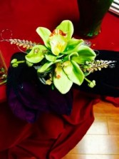 green cymbidium orchid and some bling