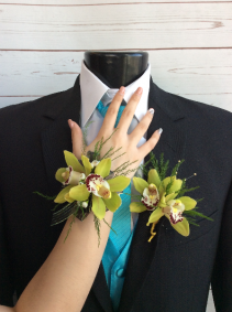 Green Orchid Corsage & Boutonniere Pair See our Corsage & Bout Pair Page
