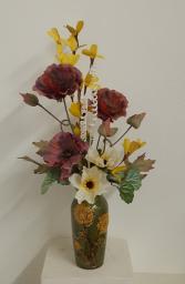 Green sunflower vase with cream and burgundy Silk flower arrangement