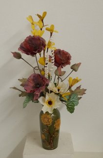 Green sunflower vase with cream and burgundy Silk flower arrangement