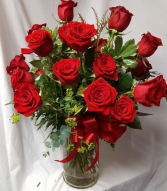 24 Red Roses arranged in a Vase with seasonal Greens and bow!