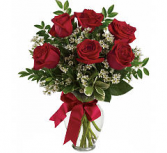 half dozen roses in a vase