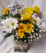 Happy Birthday Daisy arrangement. Yellow and White daisies arranged in a cute ribbon detailed rectangular vase with baby's breath and Happy Birthday Pic!