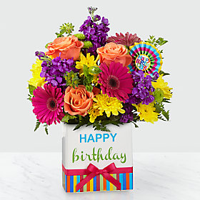 Happy Birthday!! In season spring mix bouquet in this cute ceramic Birthday container!