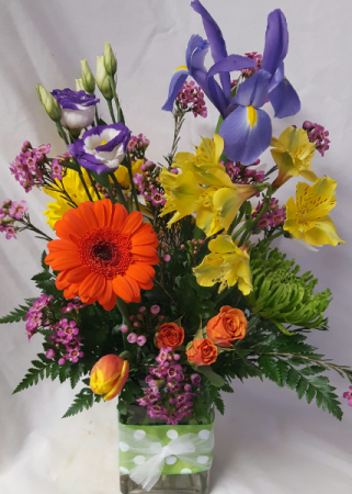 HAPPY DAYS BOUQUET..cute fabric on rectangular Vase filled with bright seasonal flowers.
