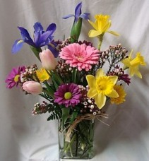 HAPPY EASTER!! Mixture of spring flowers...tulips daffodils, iris, daisies and gerbera daisy arranged in a rectangular vase.