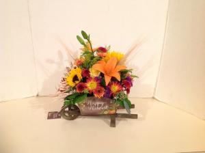 Happy Harvest Wheelbarrow  in Maple Heights, OH | NOVAK'S FLOWER SHOPPE