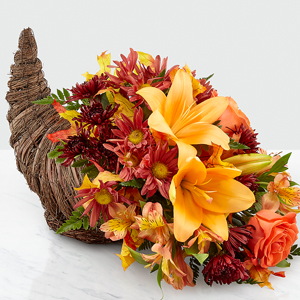 The FTD Harvet Comfort Cornicopia Centerpiece