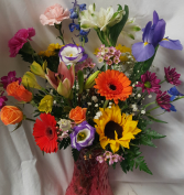 SWEET SPRING BOUQUET...seasonal bright mixed Flowers in a colored vase!